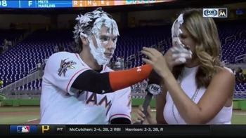 Christian Yelich decides to include Jessica Blaylock in the shaving cream party
